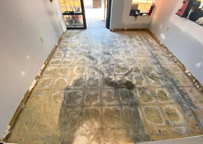 removing glue from concrete