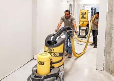 man polishing concrete floors