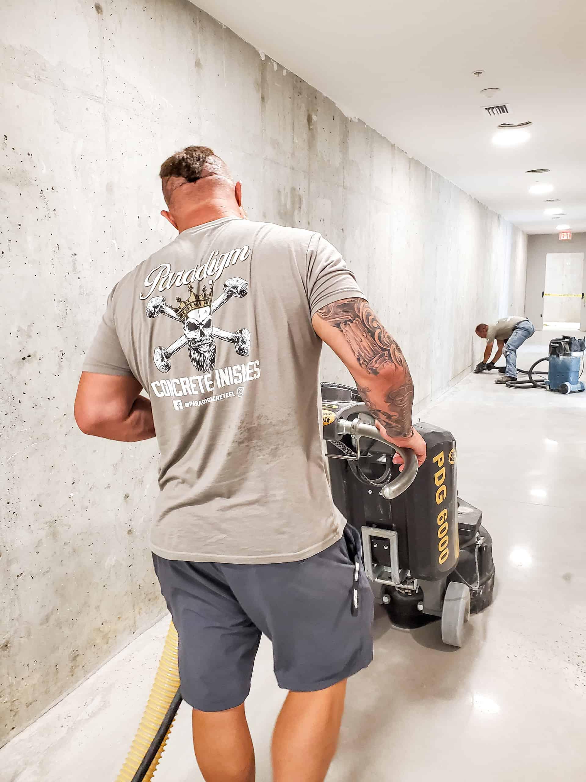 Jeremy the owner of Paradigm Concrete Finishes polishing the concrete floors